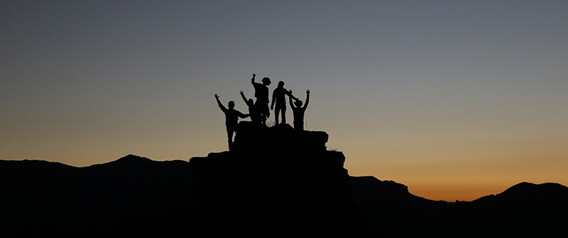 Image of a group of people summiting a mountain