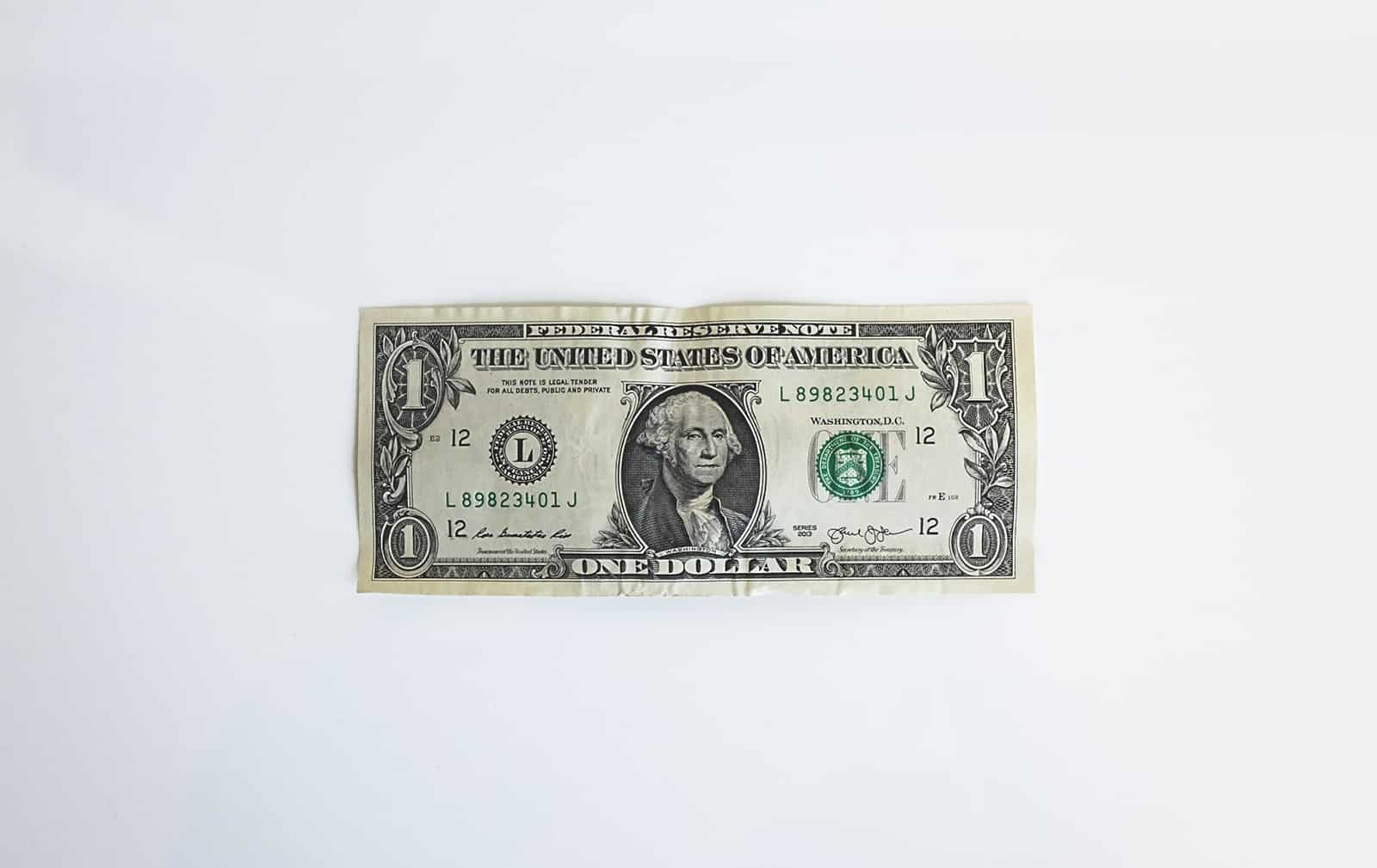 An image of a single dollar on a white background