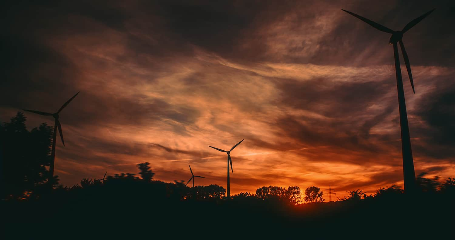 Image of wind turbines at sunset