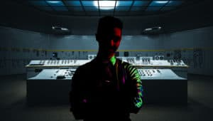 Image of a man covered in shadows inside of a control room