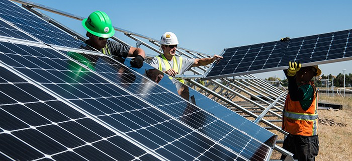 An image of workers installing solar energy panels